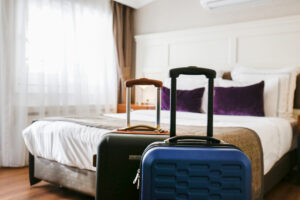 Two packed suitcases prepared for the trip. Traveling couple concept. Hotel room bed